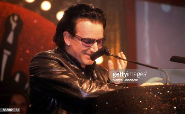 Irish singersongwriter Bono of rock group U2 winners of both 'Best Rock Act' and ' Godlike Genius' at the NME Awards Planit Arches London 6th...