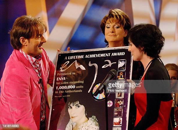 Irish singersongwriter Enya receives an award from Dutch TV presenters Gerard Joling and Catherina Keyl on the TV show Program MAX Hilversum...