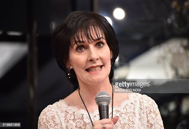 Irish singersongwriter Enya speaks at a press conference in Tokyo on March 20 2016 to announce former South African professional golfer Gary Player's...