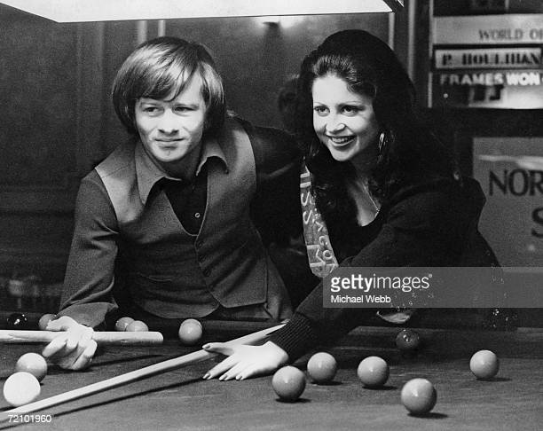 Irish snooker player Alex Higgins with Carmen Farrugia who is entering the Miss World contest as Miss Malta at the Norwich Union World Open Snooker...