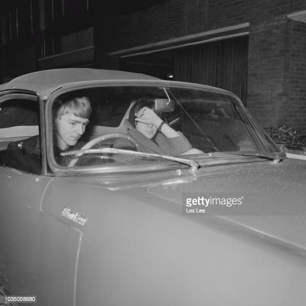 Irish socialite and heir to the Guinness fortune Tara Browne with his fiancee Noreen MacSherry in a car UK 12th November 1963