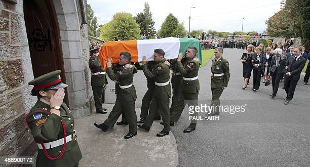 Irish soldiers carry the coffin of Thomas Kent, one of 16 men executed following the 1916 Easter Rising against British rule, followed by family...