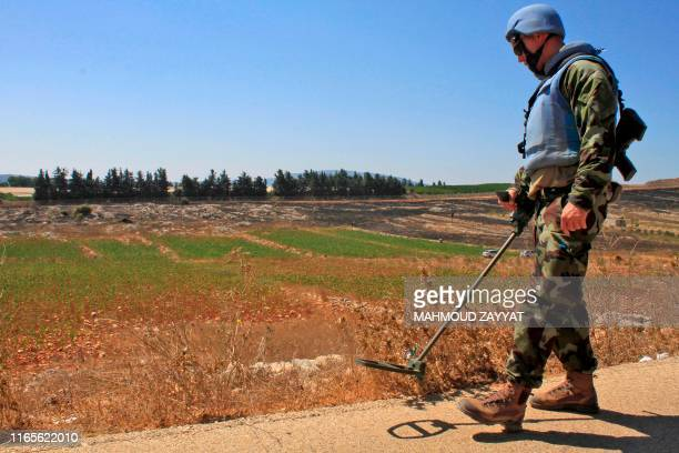 Irish soldiers of the United Nations Interim Forces in Lebanon patrol a road in the southern Lebanese village of Maroun alRas along the border with...