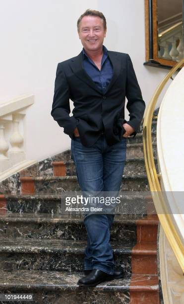 Irish step dancer Michael Flatley poses for photographer before the presentation of his new 'Lord of the Dance' tour on June 10 2010 in Munich Germany