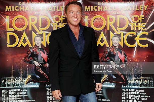 Irish step dancer Michael Flatley poses in front of the placard for the new 'Lord of the Dance' tour on June 10 2010 in Munich Germany