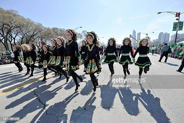 Irish step dancers participate in the St Patrick's Day parade on March 17 2012 in Chicago Illinois Tens of thousands took advantage of record high...