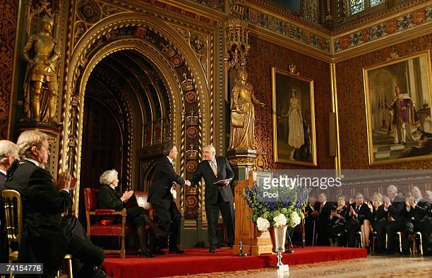 Irish Taoiseach Bertie Ahern shakes hands with his British counterpart Tony Blair after his address to representatives from both Houses of the...