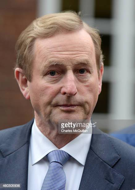 Irish Taoiseach Enda Kenny arrives for cross party talks at Stormont on December 11 2014 in Belfast Northern Ireland During the crossparty talks it...