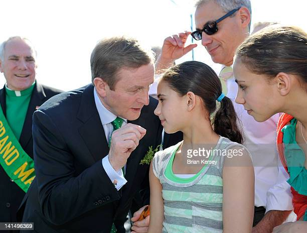 Irish Taoiseach Enda Kenny talks with Leah and Illana Emanuel daughters of Chicago Mayor Rahm Emanuel before they march in the city's St Patrick's...