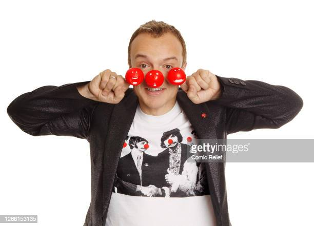 Irish television and radio presenter, comedian, actor, author, and commentator Graham Norton, wearing Red Nose Day noses on his fingers for Red Nose...