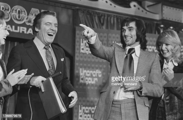 Irish television presenter Eamonn Andrews hosts an episode of the television show 'This is Your Life' with footballer George Best , UK, November 1971.