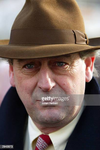 Irish trainer Noel Meade looks on after Power Elite landed The Cashmans Juvenile Hurdle Race run at Leopardstown Racecourse on February 8 2004 in...