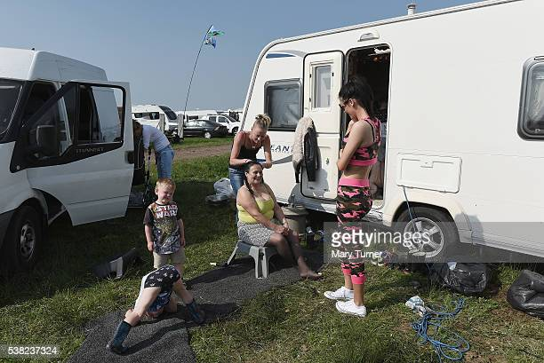 Irish travellers braid their hair and play together at the Appleby Horse Fair on June 5 2016 in Appleby England The annual horse trading fair has...