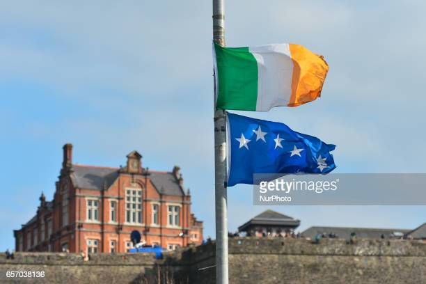 Irish tricolore and Irish Nationalist flags fly at halfstaff as the coffin of former Northern Ireland Deputy First Minister Martin McGuinness passes...