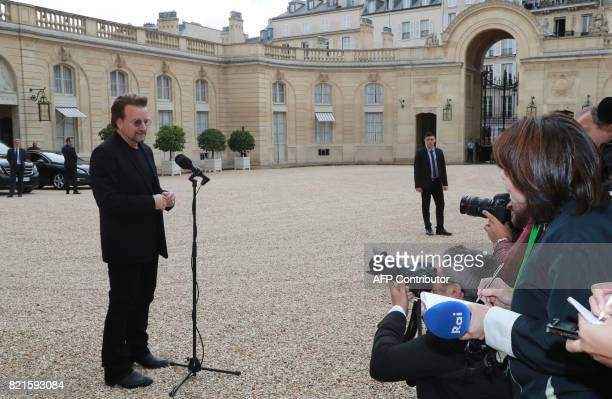 Irish U2 musician and philanthropist Bono cofounder of the organisation ONE speaks to the press following his meeting with the French president at...