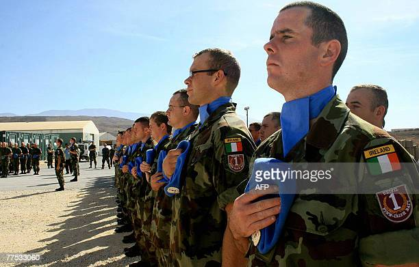 Irish UN peacekeeping soldiers take part in a ceremony at their camp in the southern Lebanese village of Blat 27 October 2007 The relationship...