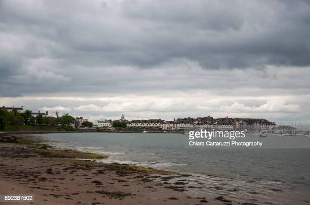 Irish village and its sandy beach in a cloudy landscape