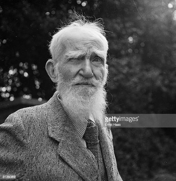 Irish writer and dramatist George Bernard Shaw , whose most famous plays include 'Pygmalion', 'Major Barbara' and 'Saint Joan', at his home in Ayot...