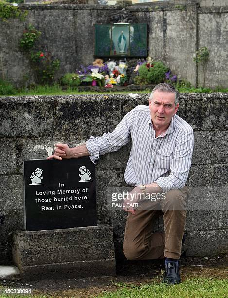 Irish writer John Pascal Rodgers poses for a photograph as he stands beside a shrine in Tuam County Galway on June 9 erected in memory of up to 800...