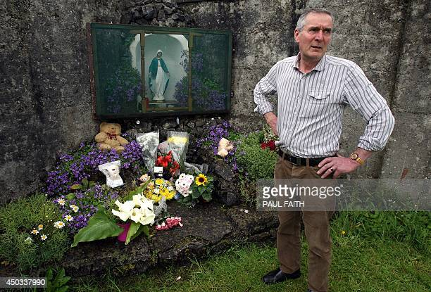 Irish writer John Pascal Rodgers stands beside a shrine in Tuam County Galway on June 9 erected in memory of up to 800 children who were allegedly...