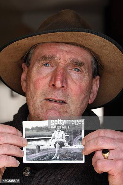 Irish writer John Pascal Rodgers who was born in Tuam County Galway at home for unmarried mothers run by nuns poses with a photograph of his mother...