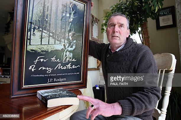 Irish writer John Pascal Rodgers who was born in Tuam County Galway at home for unmarried mothers run by nuns poses with a photograph of with a...