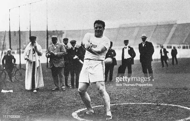 Irish-American athlete John Joseph Flanagan wins the gold medal in the hammer throw at the 1908 Summer Olympics in London, 14th July 1908.