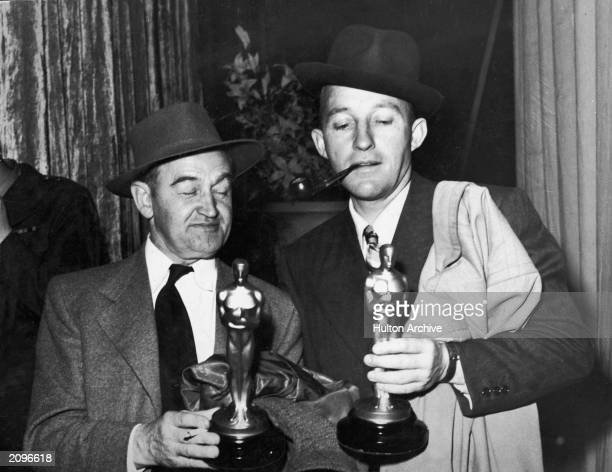 Irishborn actor Barry Fitzgerald holds his Oscar for Best Supporting Actor while American actor Bing Crosby holds his Oscar for Best Actor both for...