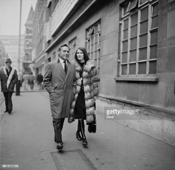 Irishborn British actor Richard Todd with his wife fashion model Virginia Mailer in Soho London UK 8th February 1971