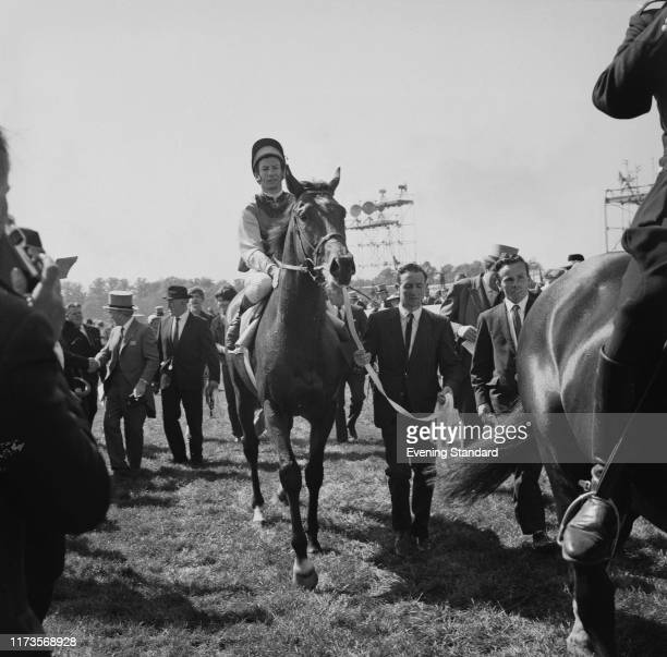 Irishtrained Thoroughbred racehorse and sire Nijinsky with his jockey Lester Piggott after winning the Epsom Derby UK 3rd June 1970