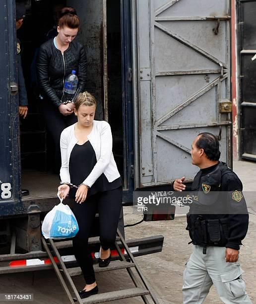 Irishwoman Michaella McCollum and Briton Melissa Reid disembark handcuffed from a truck in front of the Sarita Colonia Jailhouse Court in the port of...