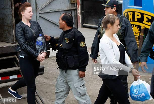 Irishwoman Michaella McCollum and Briton Melissa Reid walk into the Sarita Colonia Jailhouse Court in the port of Callao west of Lima on September 24...