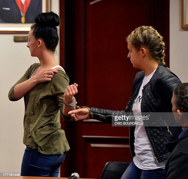 Irishwoman Michaella McCollum and Briton Melissa Reid who were arrested at Lima's airport carrying cocaine in their luggage leave the Callao...