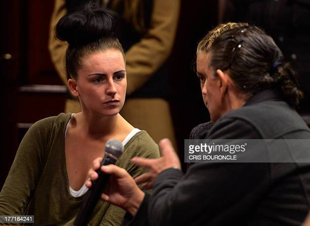 Irishwoman Michaella McCollum and Briton Melissa Reid who were arrested at Lima's airport carrying cocaine in their luggage listen to a...