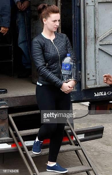 Irishwoman Michaella McCollum and companion Briton Melissa Reid disembark handcuffed from a truck in front of the Sarita Colonia Jailhouse Court in...