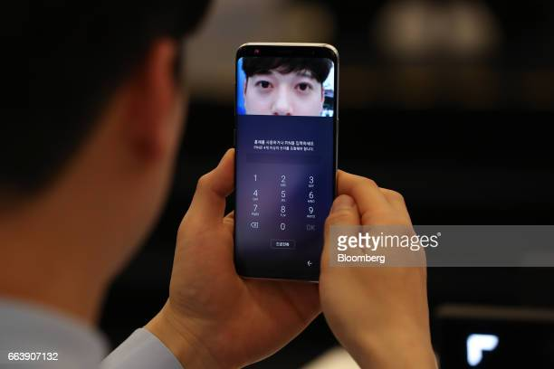 Irisscanning technology using an infrared camera is demonstrated on a Samsung Electronics Co Galaxy S8 smartphone at one of the company's promotional...