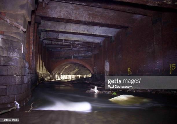 irk culvert under victoria station, manchester - victoria station manchester stock pictures, royalty-free photos & images