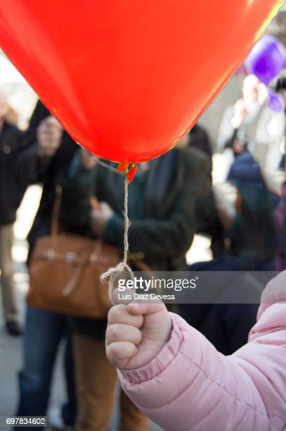 irl holding floating red balloon