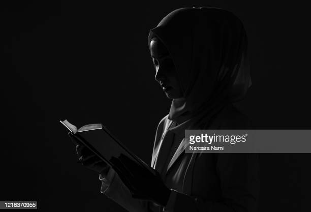 irl is reading quran. the quran is indicated as the guided book for all muslim and it is direction to be on the heaven of god. mosque, islam, religion and knowledge concept. - koran stock pictures, royalty-free photos & images