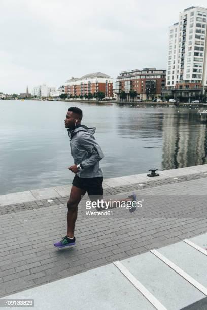 Irlenad, Dublin, young man running at waterfront promenade