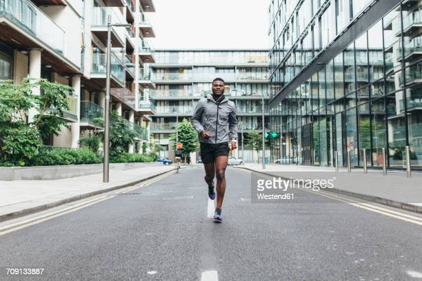 irlenad, dublin, young man running in the city - center athlete stock pictures, royalty-free photos & images
