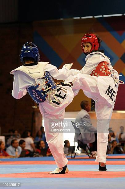 Irma Contreras of Mexico and Katherinn Reyes of Venezuela during the Taekwando women's 57kg of the 2011 XVI Pan American Games at the Gym Code II on...