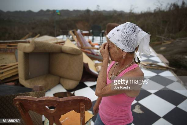 Irma Maldanado stands in what is left of her home that was destroyed when Hurricane Maria passed through on September 27 2017 in Corozal Puerto Rico...