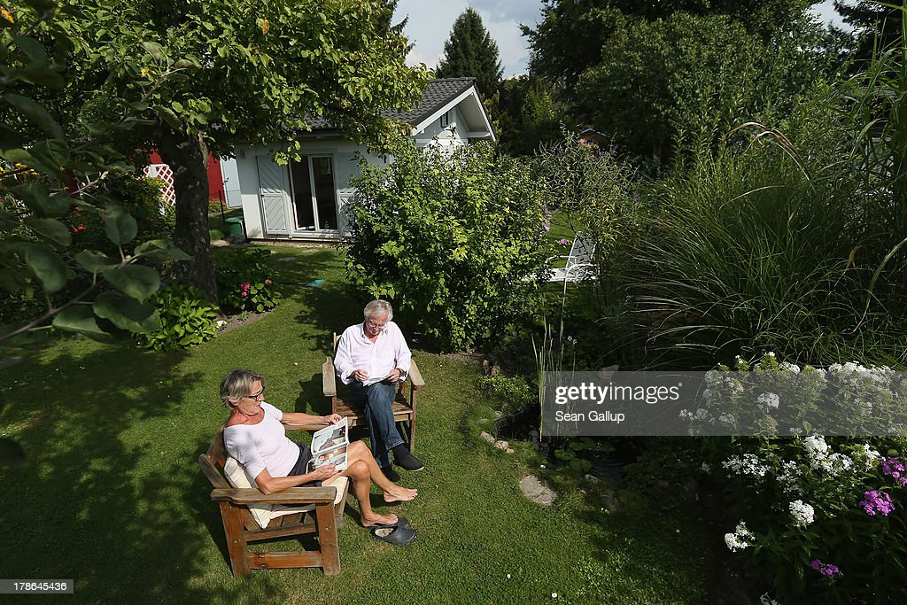 Irmgard and Uli Schade, members of the Oeynhausen Small Garden Association garden colony, relax in the garden they have leased for the last 9 years in the colony on August 29, 2013 in Berlin, Germany. At the Oeynhausen colony about 300 of its 438 gardens are currently threatened by real estate development, as are about another 24 colonies across the city. Berlin has about 900 garden colonies that are owned by the city and that provide urban dwellers who don't have land of their own the opportunity to maintain a garden and escape the stress of urban life. Berlin is currently undergoing a housing squeeze and city authorities are beginning to sell some of the colonies to developers, which has caused outrage in a city where the colonies of small gardens are a deep-seated tradition going back over a century.
