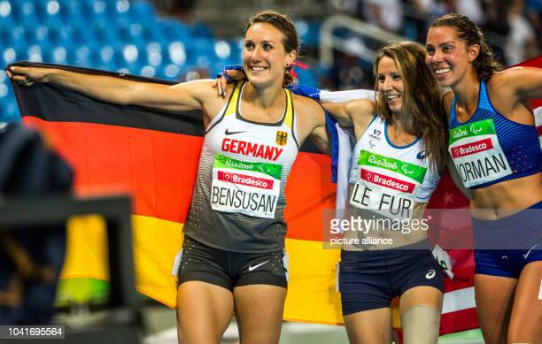 Irmgard Bensusan of Germany celebrates with MarieAmelie Le Fur of France and Grace Norman of USA after the Women's 400m T43/44 Final during the Rio...