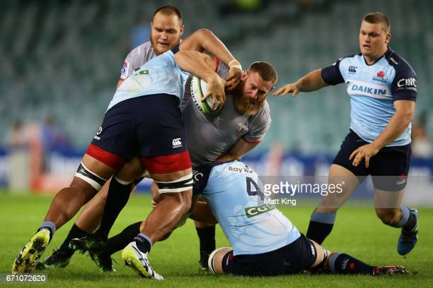 Irne Herbst of the Kings is tackled during the round nine Super Rugby match between the Waratahs and the Kings at Allianz Stadium on April 21 2017 in...