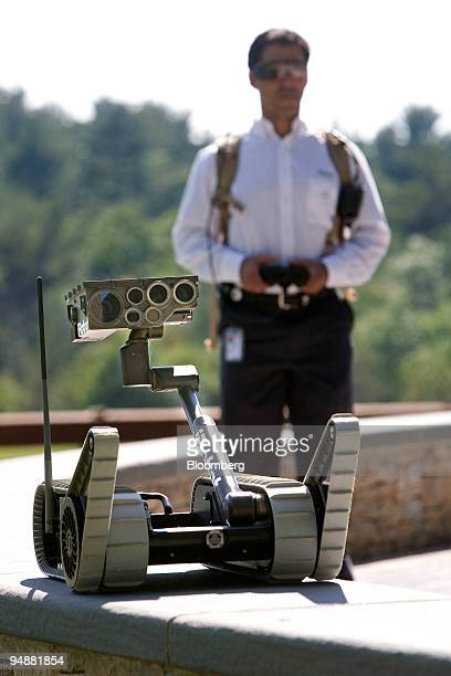 IRobot Corp. Employee Jonathan Lesser operates an iRobot Corp. Small Unmanned Ground Vehicle outside the company's new headquarters in Bedford,...