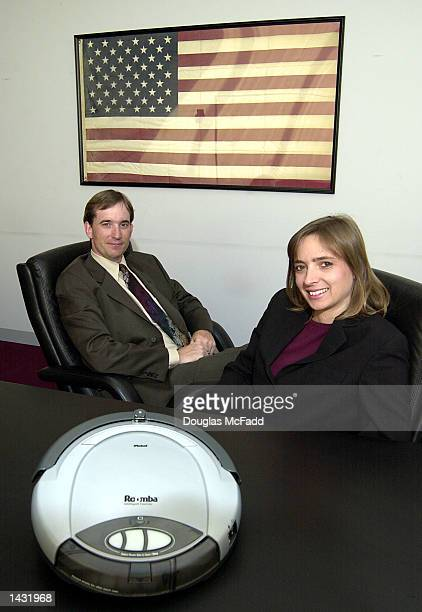 iRobot's cofounder and President Helen Greiner along with cofounder and CEO Colin Angle pose with the Roomba Intelligent FloorVac billed as the first...