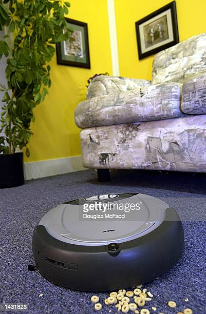 iRobot's Roomba Intelligent FloorVac billed as the first automatic floor cleaner in the US is demonstrated at company headquarters September 25 2002...