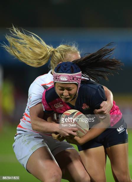 Iroha Nagata of Japan is tackled by Alex Matthews of England during the match between England and Japan on Day One of the Emirates Dubai Rugby Sevens...